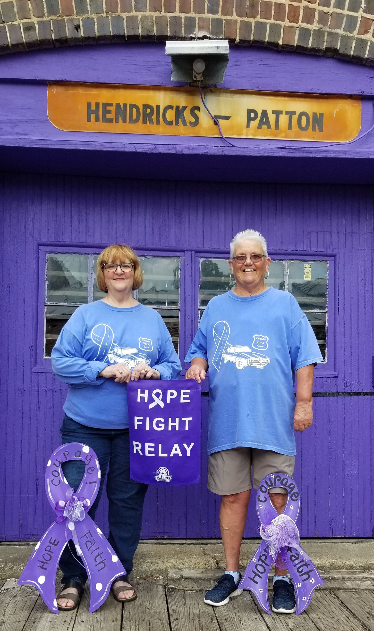 Our Relay Survivors Jennifer White and Kathy Cothren with purple ribbon