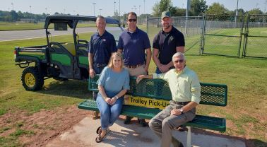 City and Trigreen officials with the new Trigreen Trolley and trolley bench