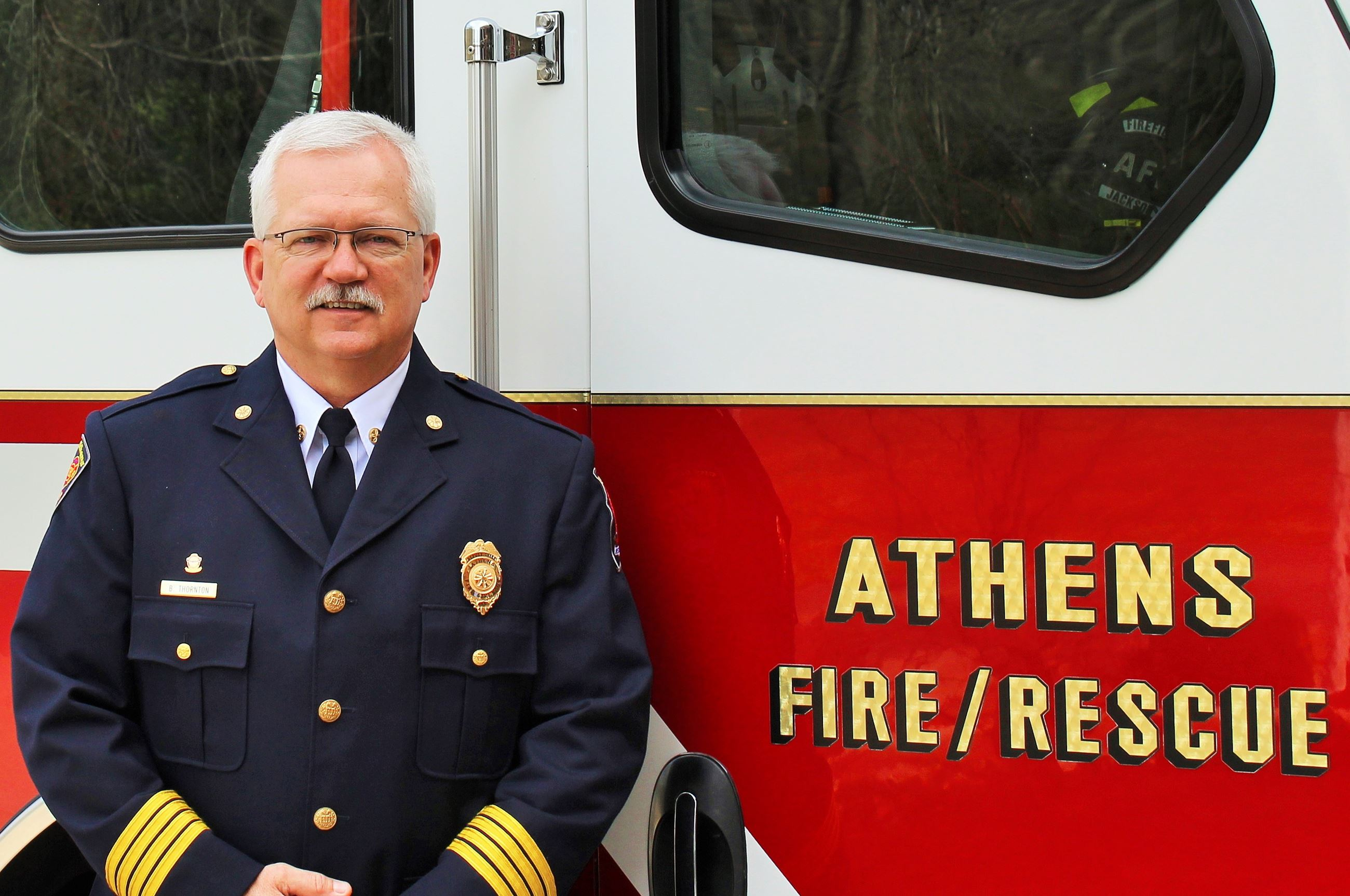 Chief Bryan Thornton in front of truck