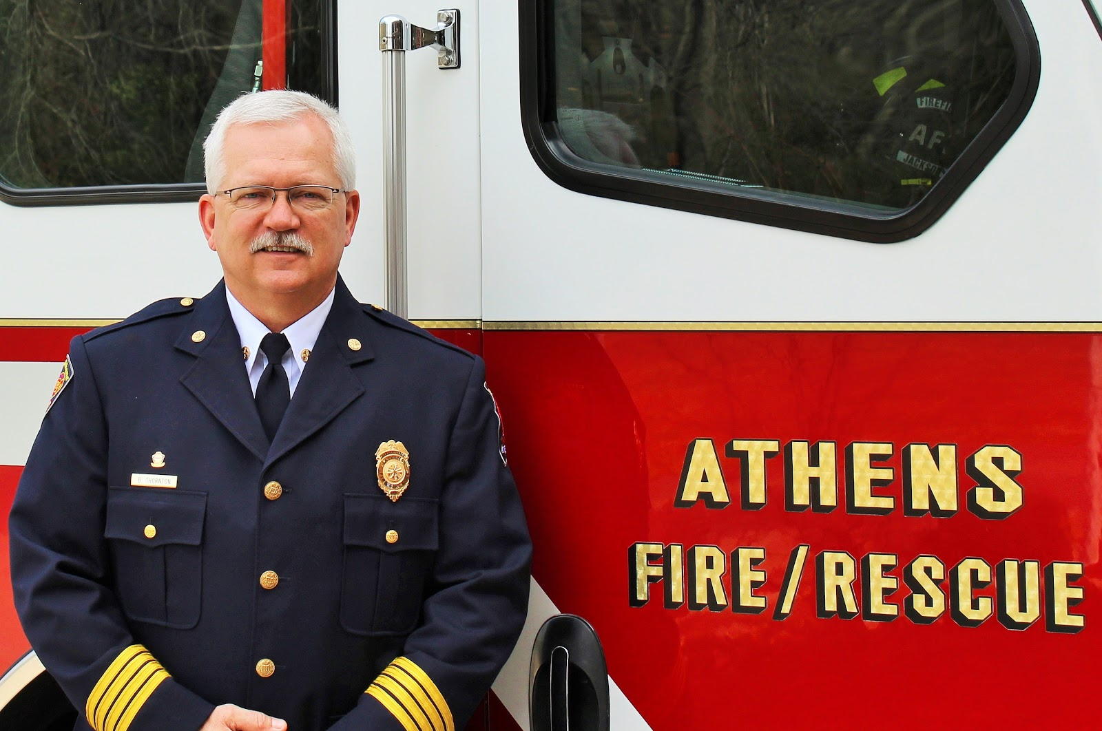 Fire Chief beside fire truck